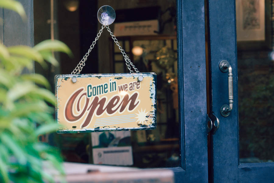 Business Insurance - Retro Looking Open Sign on a Downtown Business